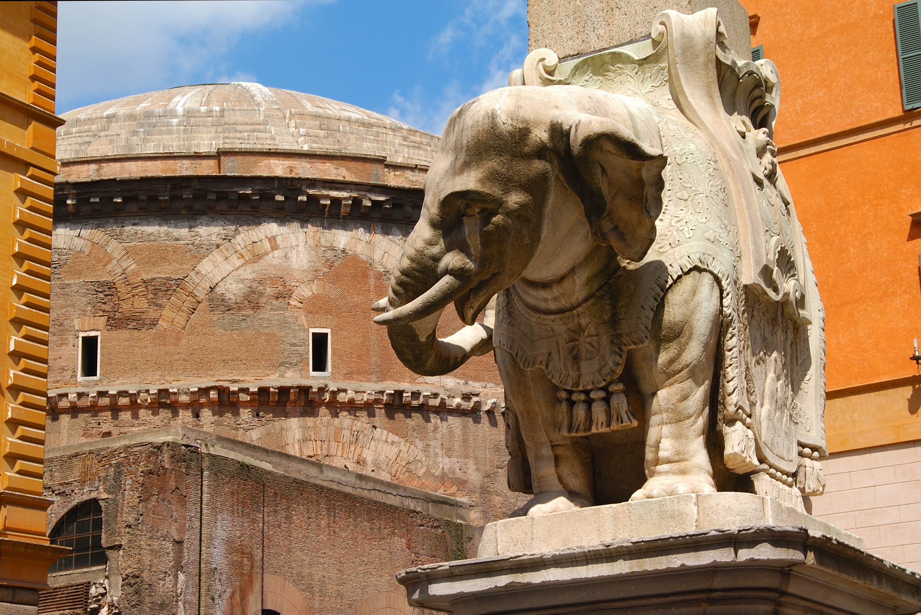 Photo of Bernini's sculpture of an elephant, in Piazza Minerva, Rome, with the Pantheon on the background.