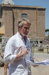 summer course tutor, Tom Parsons, reads poetry to a group in Italy