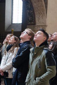 Gap year students looking up at paintings