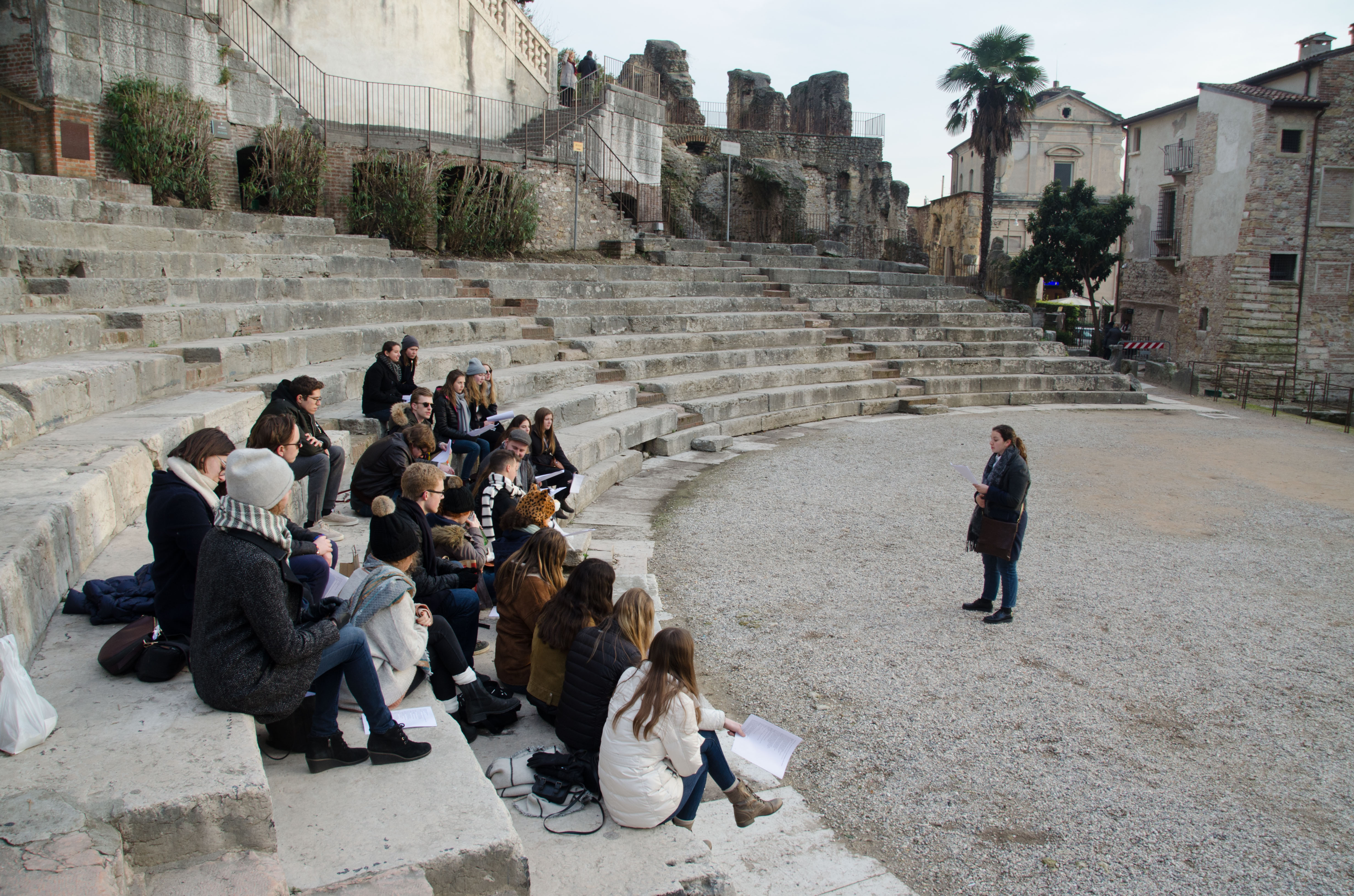 gap year students sitting in amphitheatre