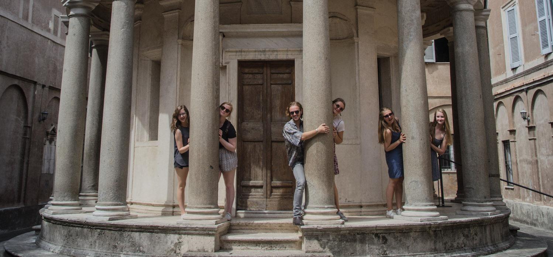 students hugging the columns of Bramante's Tempietto, Rome
