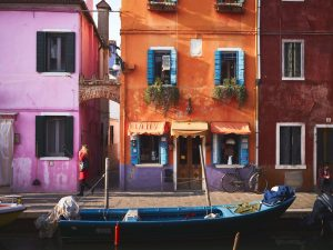 pink and orange houses in Burano, seen on a gap year course