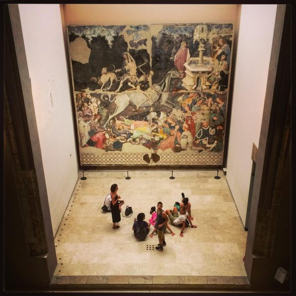 Summer course students in front of huge fresco at Palazzo Abatellis, Palermo