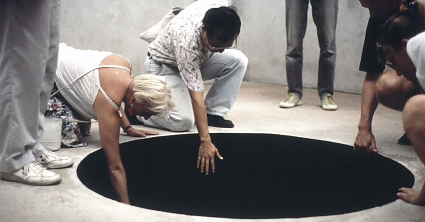 People testing Anish Kapoor's Black Hole