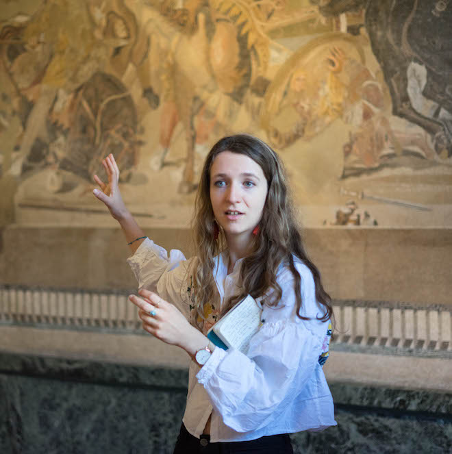 Gap Year course tutor teaching in front of Roman fresco